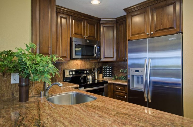 E101 Kitchen counters, stainless steel fridge/freezer combo, and new artisan cabinets