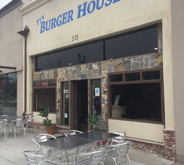 Ty's Burger House Storefront with outdoor tables and metal chairs