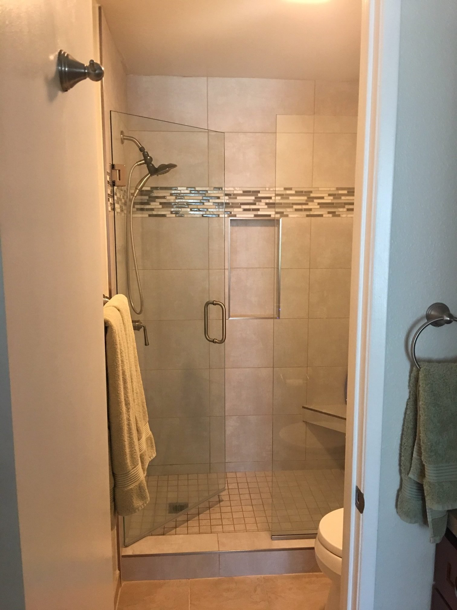 Unit F-106 step in shower with seat and glass door