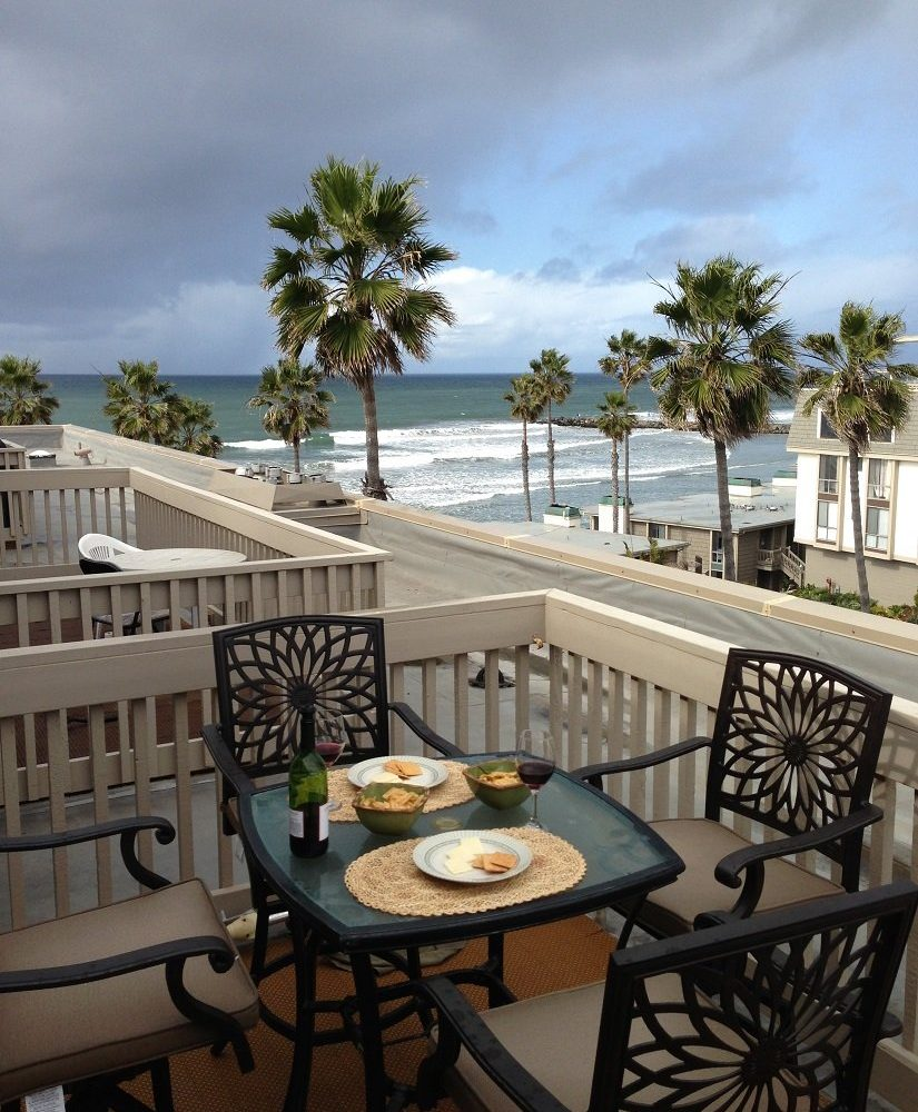 D307,balcony with table and chairs to enjoy your meals with views of the Ocean