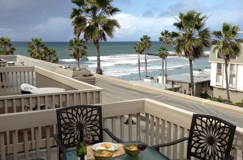 D307 balcony with table and chairs to enjoy your meals with views of the Ocean